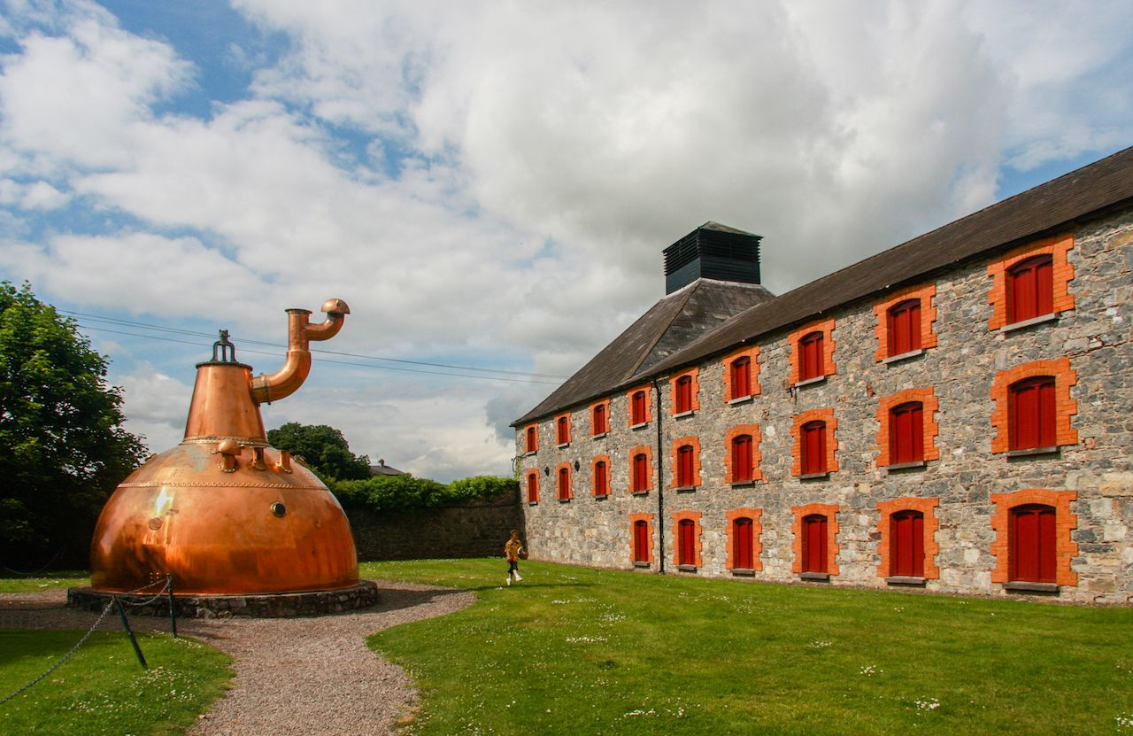 Old big copper whiskey distillery on stone foundation at the Jameson Heritage Center in Midleton Co. Cork