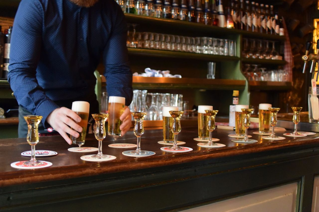 kopstoot, a Dutch beer and shot combo, line at a bar in Amsterdam
