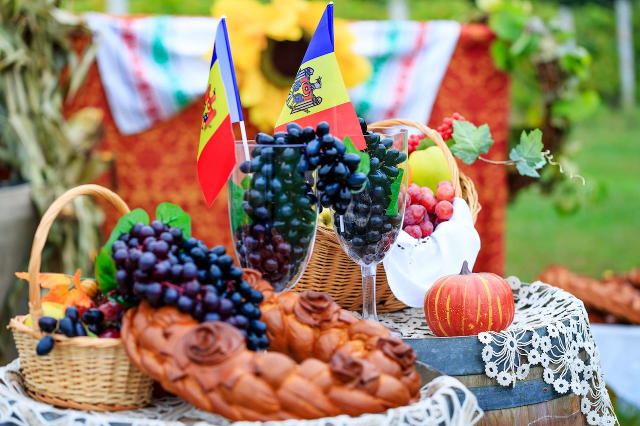 Moldovan picnic with national flag and grapes in wine glasses