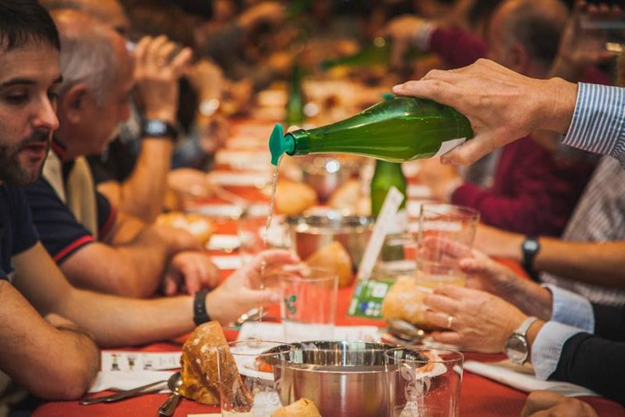 Basque meal and cider pouring from the Sagardoa Route