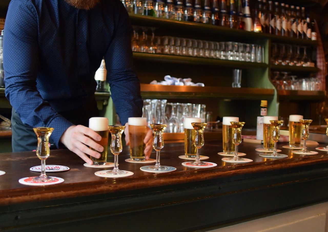 kopstoot beers with shots in an Amsterdam bar